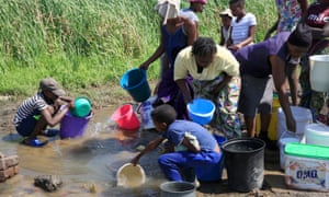 Women and children fetch water in the township of Luveve in Bulawayo.