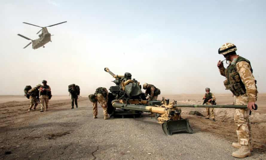 A 105mm gun is dropped by a Chinook helicopter to British 29 Commando Regiment Royal Artillery on the Fao Peninsula in southern Iraq