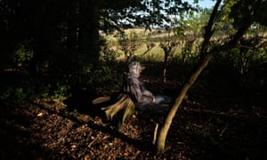 An activist rests in the anti-HS2 protest camp in Jones' Hill Wood near Great Missenden, Buckinghamshire.