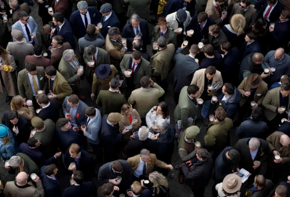 Racegoers drinking in the Arkle Bar before racing during day four of the Cheltenham National Hunt Racing Festival at Cheltenham Racecourse on March 13th 2020 in Gloucestershire