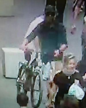 Surveillance video showing man pushing a mountain bike