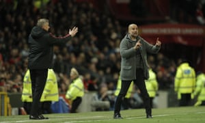Manchester United manager Ole Gunnar Solskjaer, left, and Manchester City coach Pep Guardiola gesture to their charges.