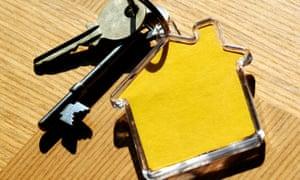 House keys and house shaped keyring