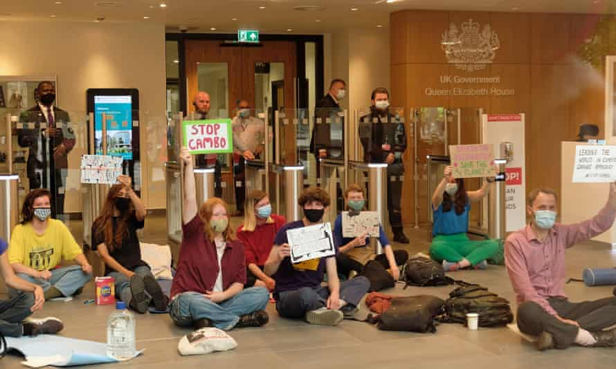 Climate activists blocking the entrance to a new UK government hub in Edinburgh in July to protest against the Cambo oilfield's approval.