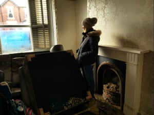 """Anne Thomson stands in her front room with debris from the water scattered as a remnant. 'Within an hour the water in our home went from zero to five foot high. The house is now worth nothing."""""""