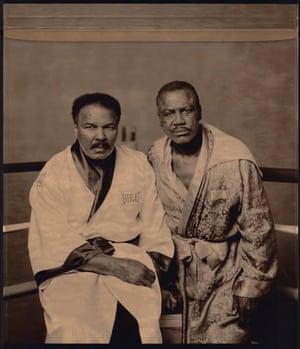 Boxing legends Muhammad Ali and Joe Frazier sit for a portrait in Philadelphia, 2003