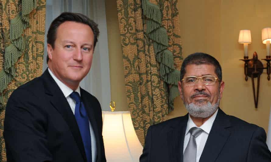 David Cameron with then Egyptian president Mohamed Morsi in 2012.