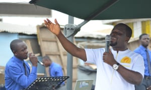 Apostle Michael Sarfo, who sets up at a busy intersection every weekday morning with other pastors and their loudspeakers to spread the gospel.