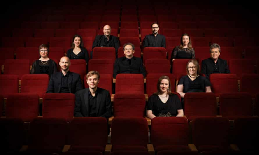 The Tallis Scholars with director Peter Phillips, centre.