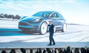 Elon Musk dancing onstage in Shanghai at a ceremony to mark the first deliveries of Tesla's Model 3 cars to customers in China