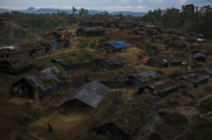 A new settlement of Rohingya refugees begins to form in hills off the main road on 10 September in Whaikhyang, Bangladesh