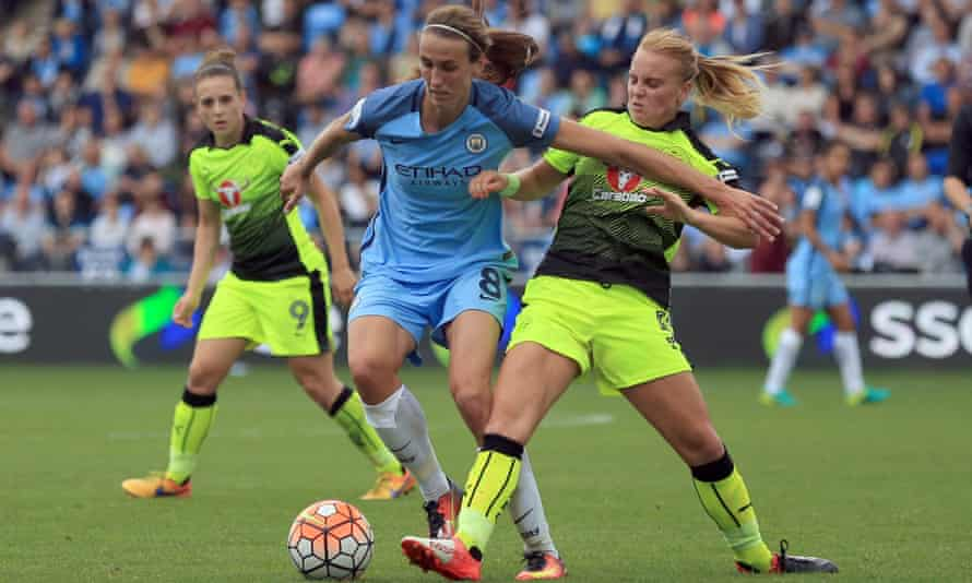 Manchester City's Jill Scott shrugs off a challenge in a game against Reading
