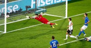 Buffon is beaten by Ozil's close-range shot.