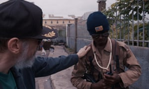 'I'm always looking for comedy that really isn't funny' ... Larry Charles with Special Forces, a former Liberian child soldier, in his Dangerous World of Comedy.