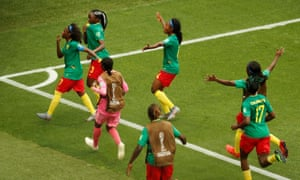 Cameroon's Ajara Nchout (second left) celebrates scoring their first goal with her teammates.