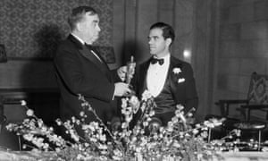 Frank Capra collecting an Oscar actually intended for him at the 1935 Oscars ceremony.