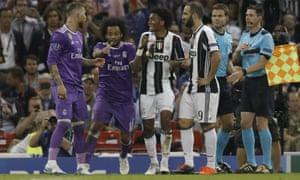 Juan Cuadrado, third left, and Sergio Ramos, left, discuss the challenge and Ramos' reaction.
