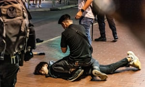 10 May 2020: an anti-government protester being restrained by police during a demonstration in Mongkok district, Hong Kong.