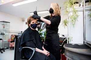 Edinburgh, Scotland Scotland's First Minister Nicola Sturgeon, wears a face covering, as she has her hair coloured and cut by Julie McGuire at Beehive Hair and Make up hairdressers' salon, during campaigning for the Scottish Parliamentary election