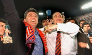 Radomir Antic (left) celebrates with Atlético Madrid's president, Jesús Gil, after leading the club to the La Liga title in 1996.