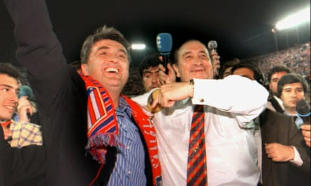Radomir Antic celebrates with Atlético Madrid's president, Jesús Gil, after leading the club to the La Liga title in 1996.