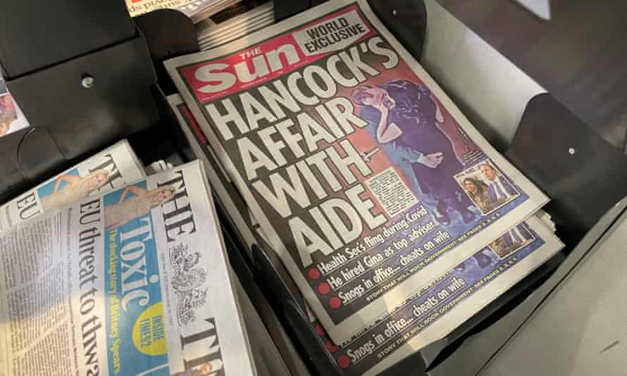 Sun front page showing Hancock in clinch with aide