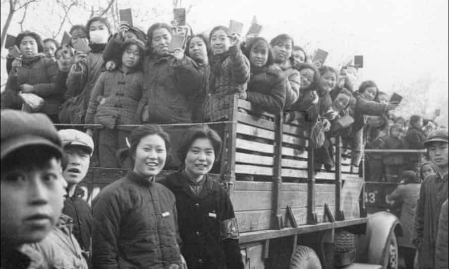 A propaganda squad of Red Guards, high school and university students, brandishing copies of Chairman Mao Zedong's Little Red Book in 1966.