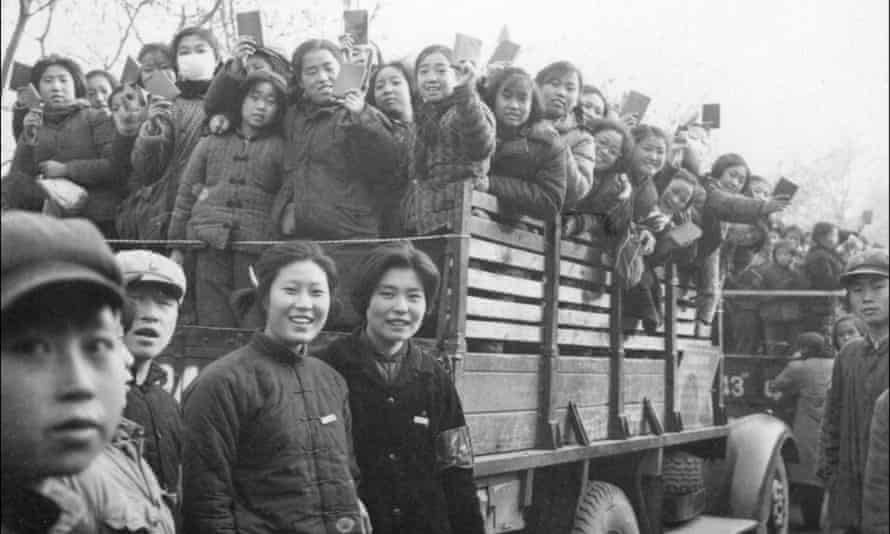 Red Guards brandishing copies of Mao's Little Red Book, as they parade in Beijing's streets during the Cultural Revolution, launched in 1966.
