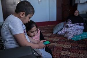 Emran, 8, and his sister Emra, 4