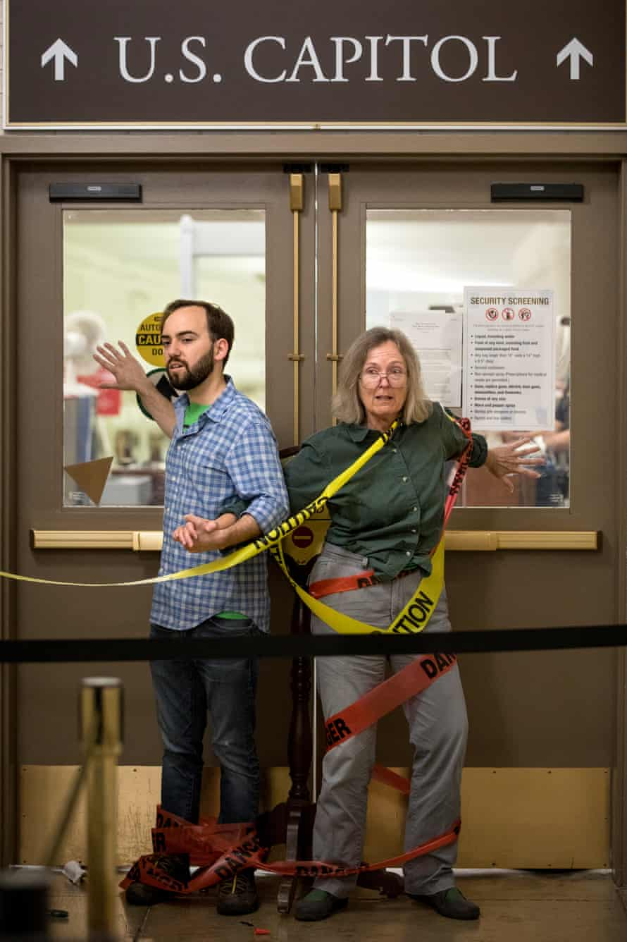 Climate activists from Extinction Rebellion glue themselves in doorways.