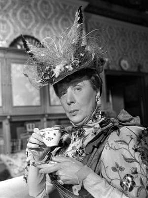Dame Edith Evans enjoys a cup of tea as Lady Bracknell in The Importance of Being Earnest, 1951.