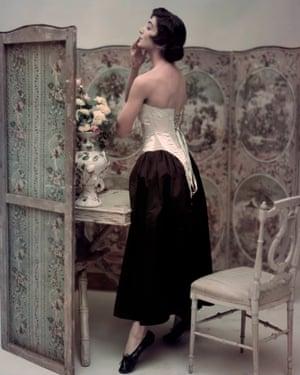Carmen Dell'Orefice wearing a corset in Vogue, 1947
