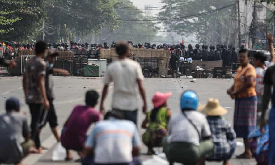 Myanmar riot police block a road in Yangon during a protest against the military coup