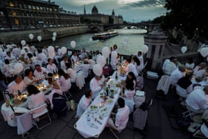 """Paris, FranceParticipants dressed in white participate in a """"Diner en Blanc"""" (Dinner in White) on the Arcole bridge. It's the 29th Edition of the Diner en Blanc"""