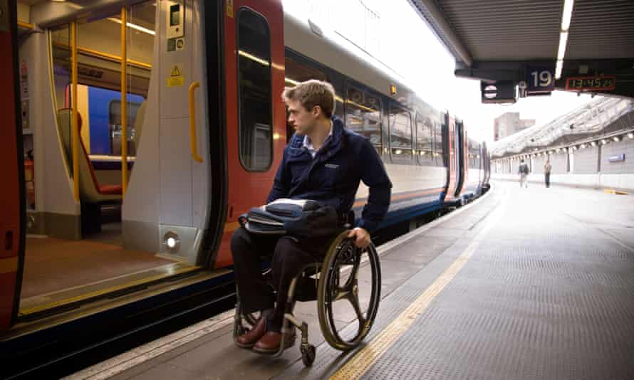 Disabled passenger at railway station in London