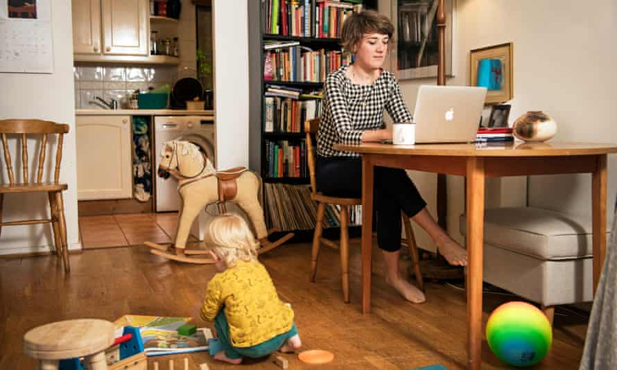 Nell Frizzell at work at home while looking after her son