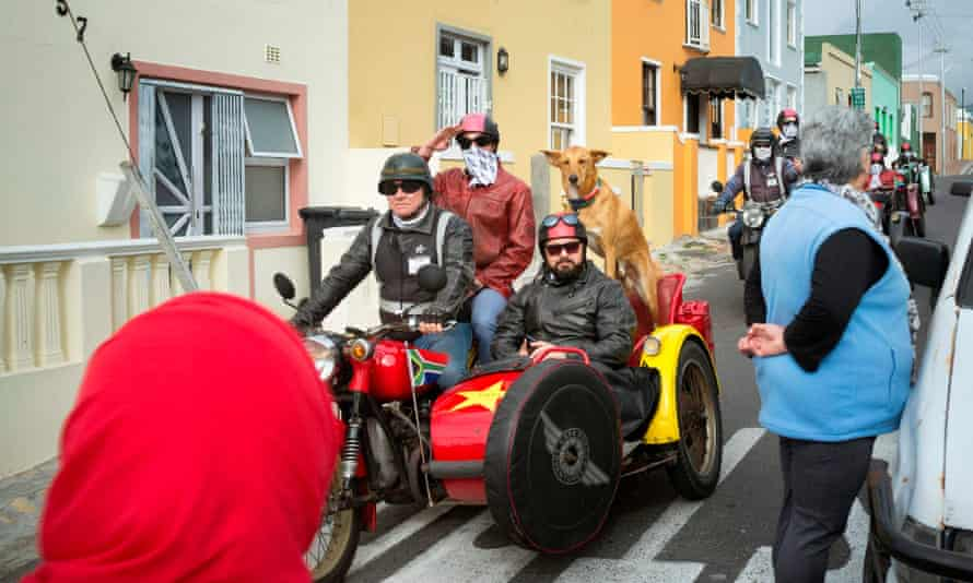 Tourists ride through Bo-Kaap on motorcycles. The district is a big draw for visitors.