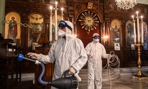 Workers of Istanbul's Metropolitan Municipality disinfect the Panagia Altimermer Greek Orthodox church in Istanbul to prevent the spread of coronavirus on March 15, 2020.