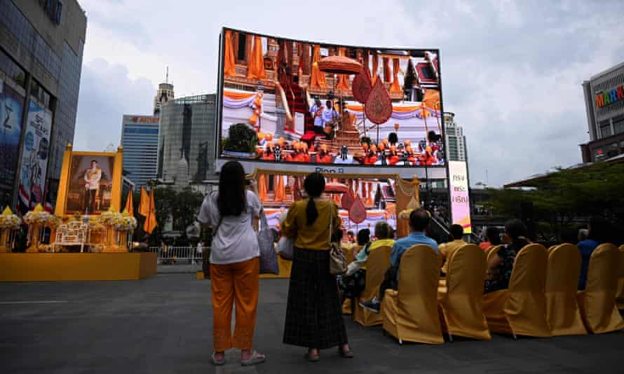 People watch the live broadcast of the coronation ceremony in Bangkok.