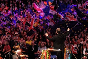 The audience wave British and EU flags