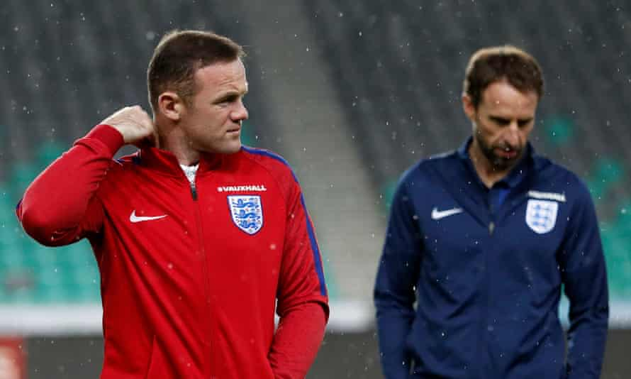 England interim manager Gareth Southgate (right) and Wayne Rooney walk on the pitch in Ljubljana.