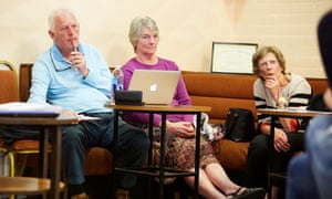 People listen to a speaker at a public meeting of the Campaign for Abortion Law Modernisation in Douglas