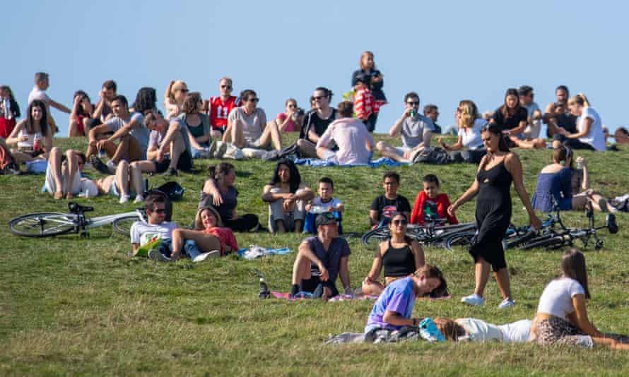 People enjoy the sunshine on Primrose Hill, London, September 2020.