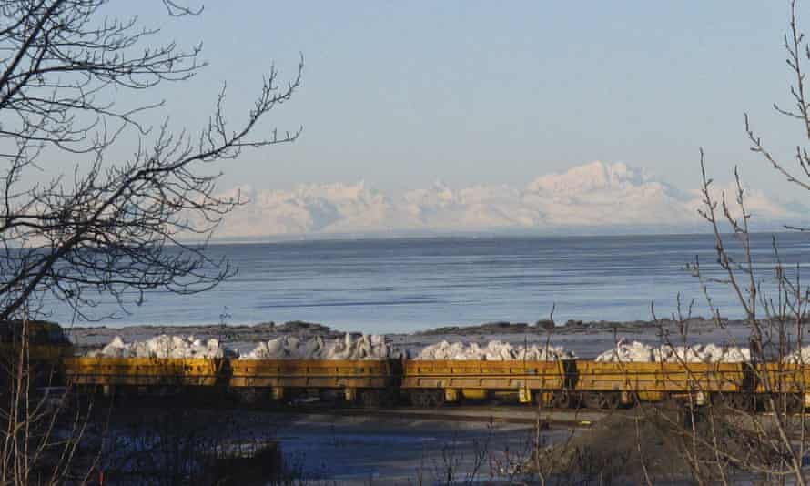 Tons of snow is brought into Anchorage by train earlier this month to provide a picturesque backdrop for the ceremonial start of the Iditarod dog sled race. Record high winter temperatures have deprived the Alaskan city of snow.