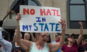 Cathi Lyninger of Louisville protests the neo Nazis in Pikeville.