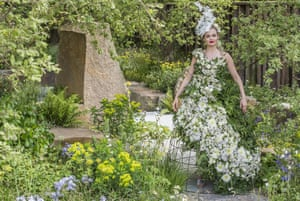 Blending in: a model wears a dress made from 1,500 real flowers in the M&G garden