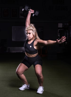 Fitness instructor Laura Hoggins lifting a weight