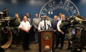 Atlanta's police chief, George Turner, answers questions about the death of Alexia Christian on 1 May. Turner said Christian managed to free one hand and pull out a gun.