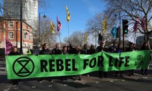 Activists block road