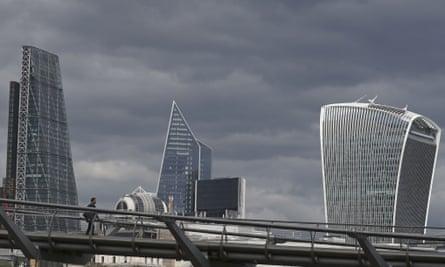 A man walks across the Millennium Bridge in London during the coronavirus pandemic